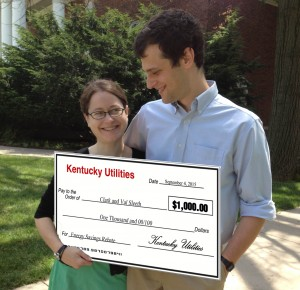 Clark and Val with their rebate check. Just kidding: we obviously photoshopped this. But wouldn't it be cool of they gave giant checks for energy savings?